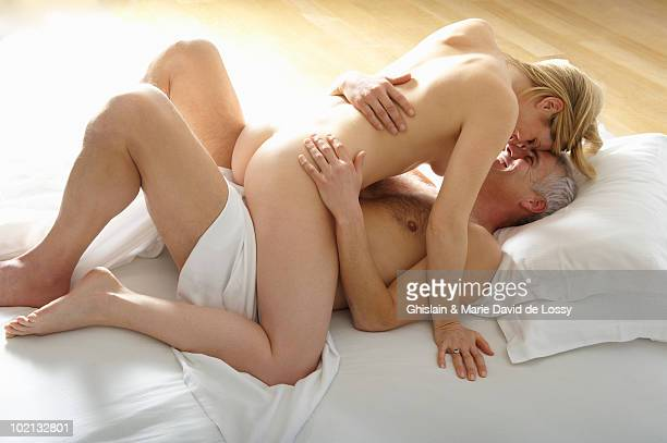 man and woman in bed - male female nude stock pictures, royalty-free photos & images