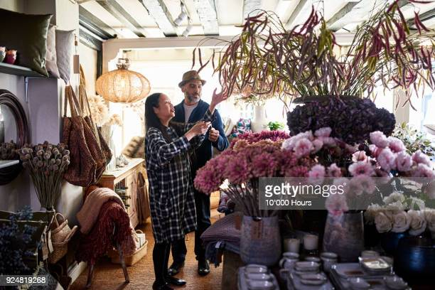 man and woman in boutique - purple dress stock pictures, royalty-free photos & images