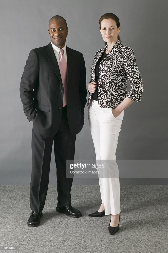 Man and woman in business attire : Stockfoto