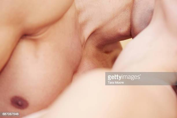 man and woman in embrace - satisfaction stock pictures, royalty-free photos & images