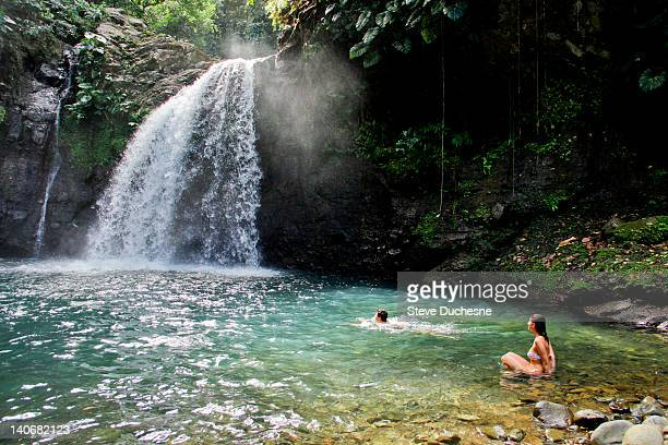 man and woman in lezarde fall - guadeloupe photos et images de collection