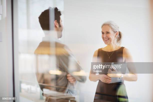 man and woman in office having a meeting