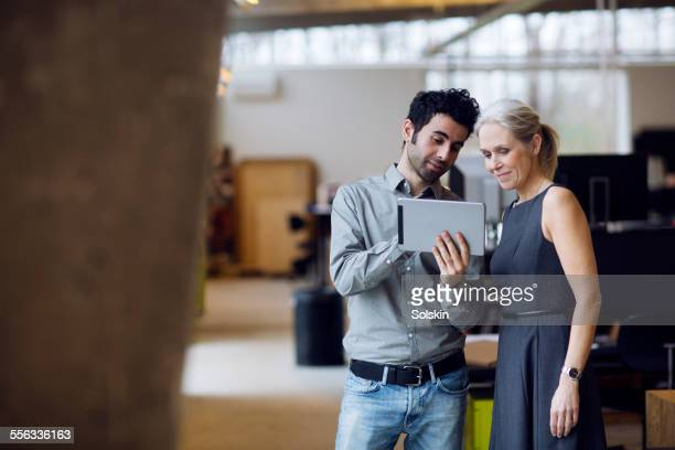 man and woman in office having a meeting - employee engagement stock pictures, royalty-free photos & images