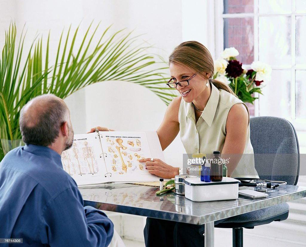 Man and woman in office : Stock Photo