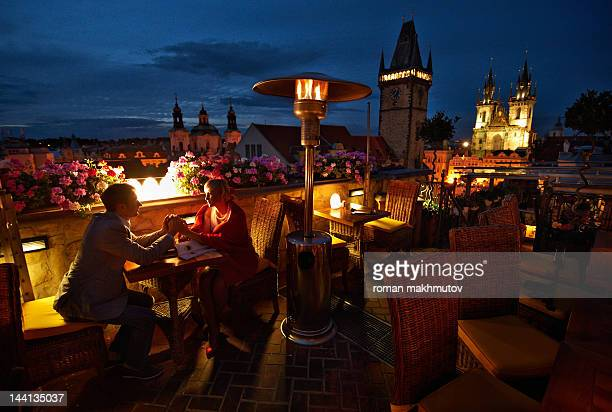 Man and woman in Prague rooftop cafe
