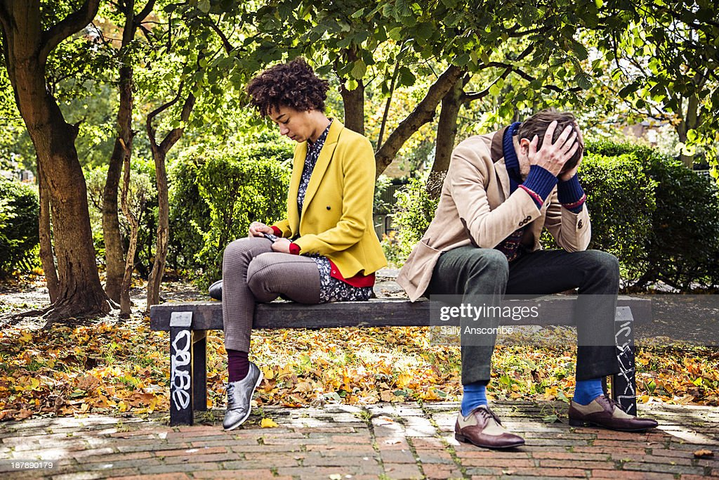 Man and woman in the park : Stock Photo