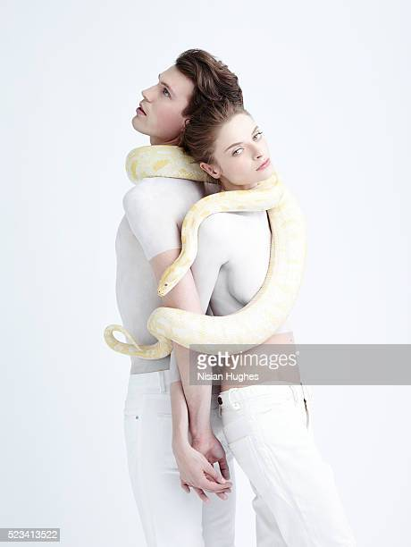Man and Woman in white with snake