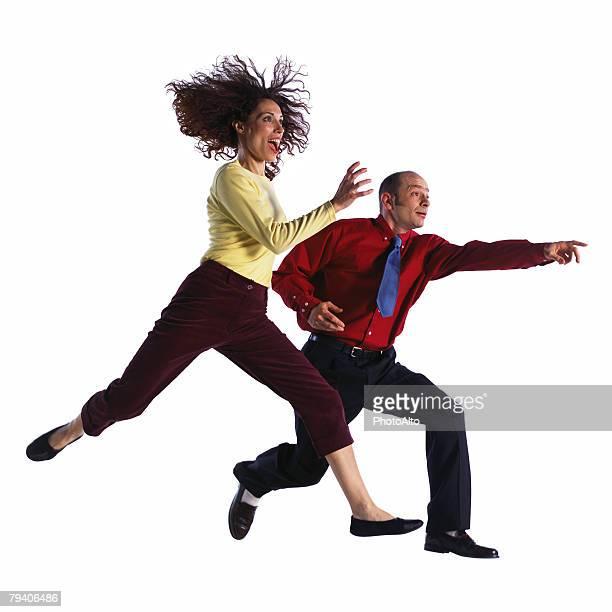 man and woman jumping - 手を伸ばす 男性 ストックフォトと画像