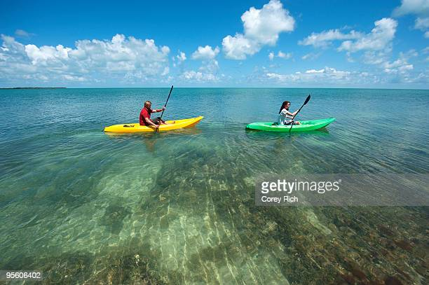 a man and woman kayak in florida. - key west stock photos and pictures