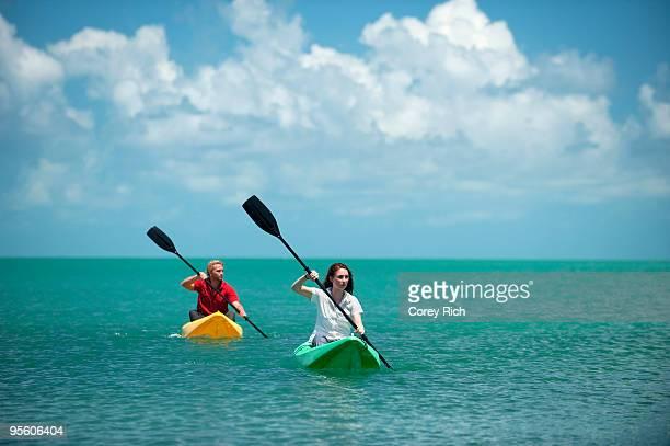 A man and woman kayak in Florida.