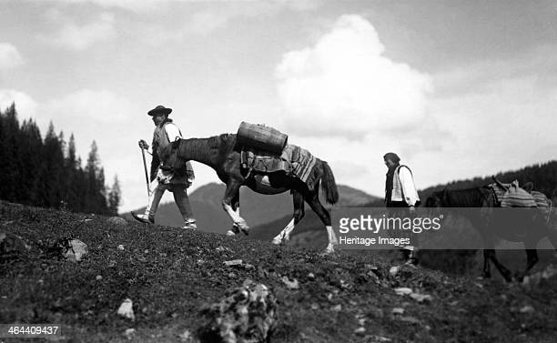 Man and woman leading horses Bistrita Valley Moldavia northeast Romania c1920c1945 Depicting customs and traditional labour in the rural Carpathian...