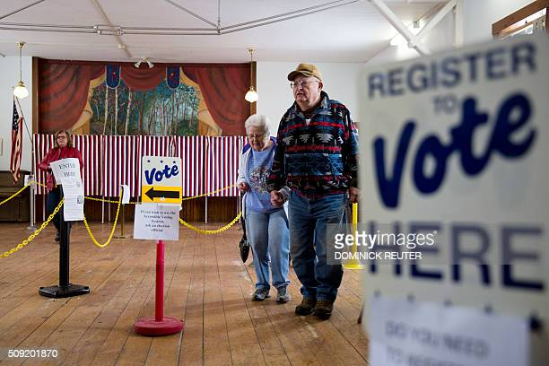 A man and woman leave after casting their ballots February 9 in Chichester New Hampshire New Hampshire voters headed to polls at the snowy break of...