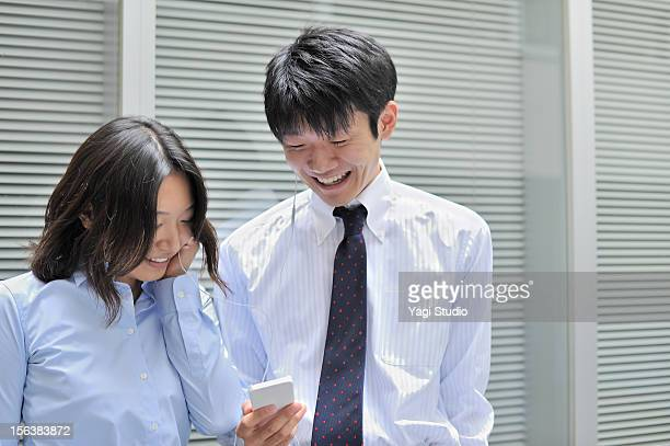 Man and woman listening to music , smiling