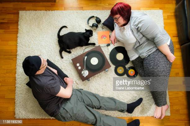 Man And Woman Listening To Records On The Floor