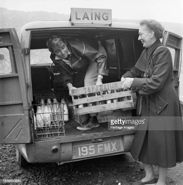 Man and woman loading a van with crates of food and drink from the canteen at the headquarters of the London to Yorkshire Motorway project, for staff...
