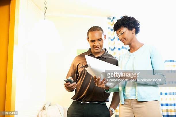 man and woman looking at documents together