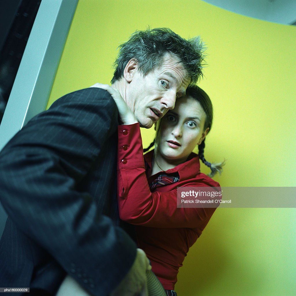 Man and woman looking into camera, man holding woman's leg. : Stockfoto