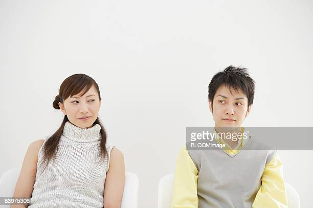 Man and woman looking sideways at each other