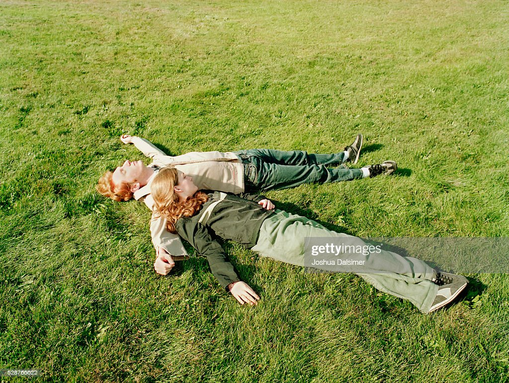 Man and woman lying on grass : Stock Photo