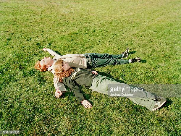 Man and woman lying on grass