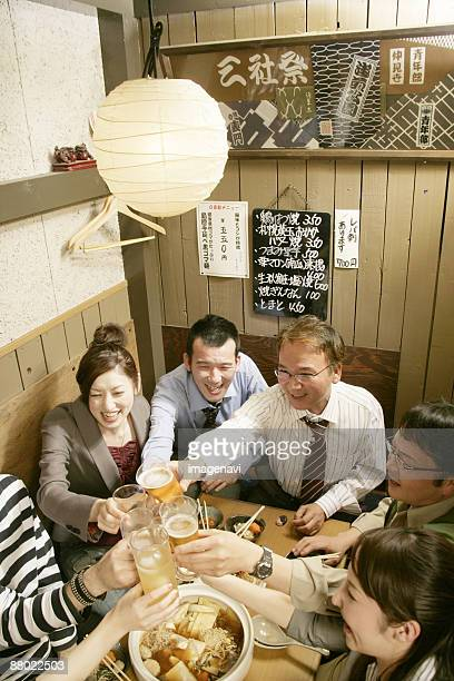Man and woman making a toast in the Japanese-style pub