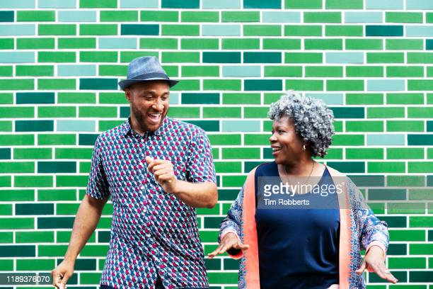 man and woman messing about, dancing - wellness stock pictures, royalty-free photos & images