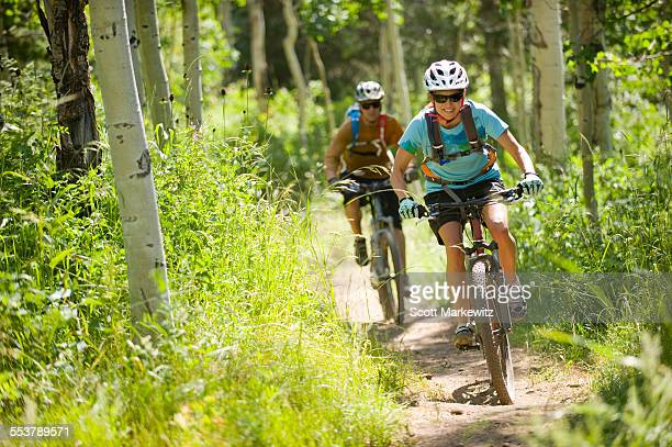 man and woman mountain biking, park city, utah. - park city stock photos and pictures