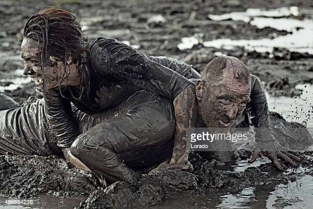 man and woman mud wrestling