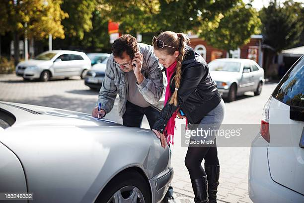 Man and woman near car