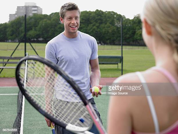 Man and woman on a tennis court
