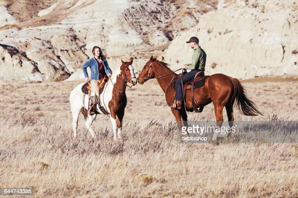 man and woman on horseback - istock images stock pictures, royalty-free photos & images