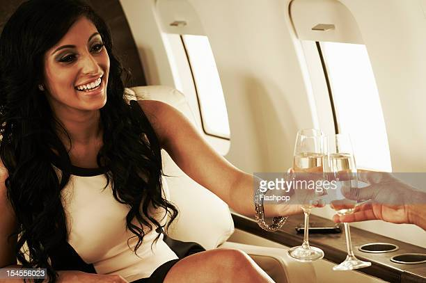 Man and woman on private jet celebrating
