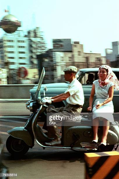 man and woman on scooter - showa period stock pictures, royalty-free photos & images
