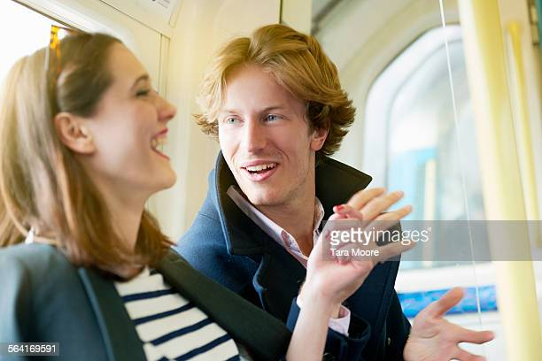 Man and woman on underground laughing together