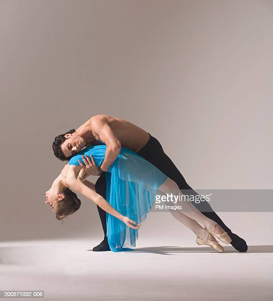 Man and woman performing ballet pose