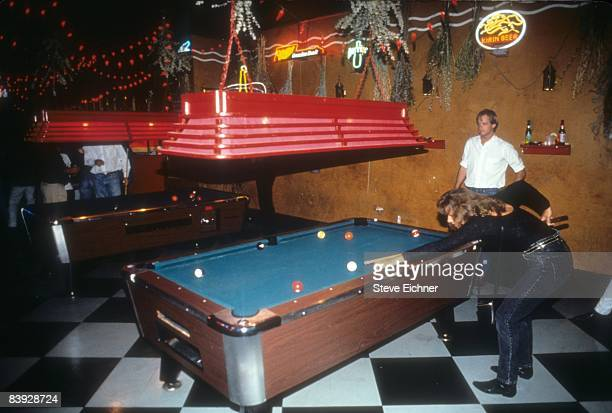 Man and woman play pool inside one of the rooms in Webster Hall, a party and dance venue in New York City, ca.1993.