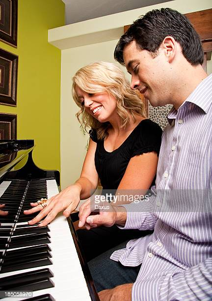 Man and Woman Playing a Piano