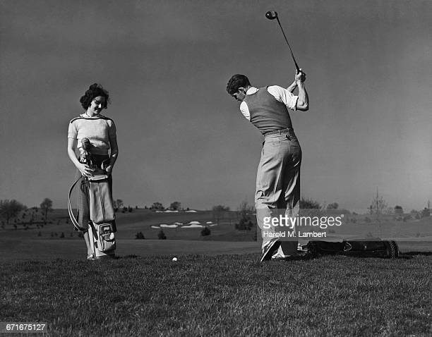 man and woman playing golf  - {{relatedsearchurl(carousel.phrase)}} stock pictures, royalty-free photos & images