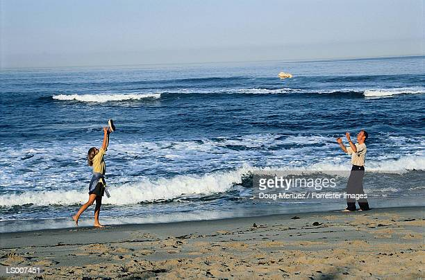 Man and Woman Playing on Beach