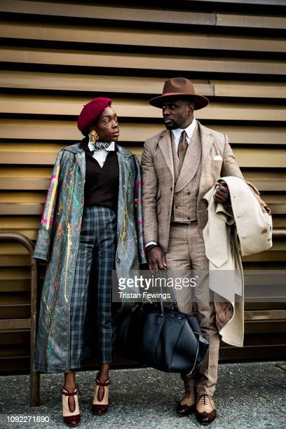 A man and woman pose for a photograph during the 95th Pitti Uomo at Fortezza Da Basso on January 10 2019 in Florence Italy