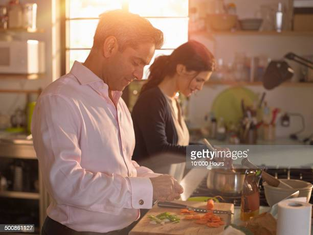 Man and woman preparing an evening meal