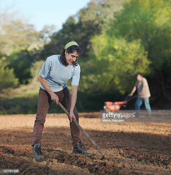 Man and woman preparing soil for sowing