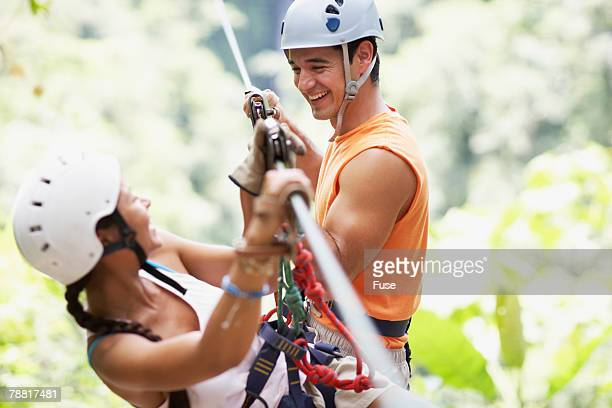 Man and Woman Rappelling