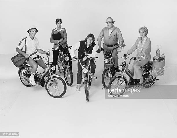 Man and woman riding motorbike on white background