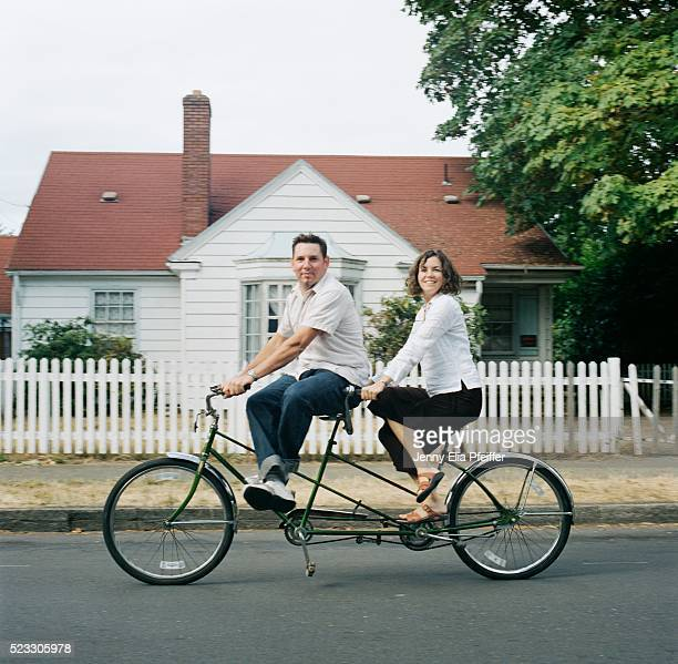 Man and woman riding tandem bicycle