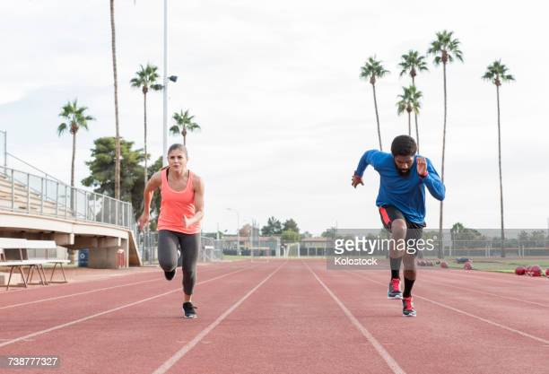 Man and woman running on track