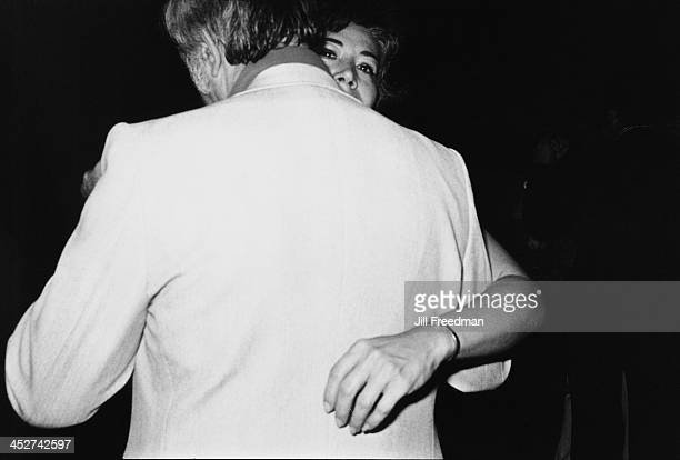A man and woman share a moment on the dancefloor at a singles party night New York City 1976