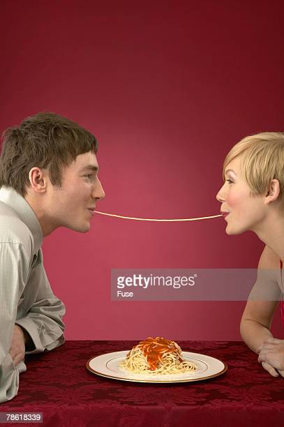 Man and Woman Sharing Spaghetti