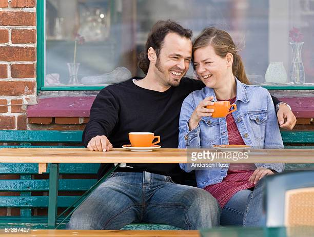 Man and woman sitting at a cafe