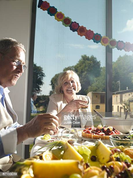 Man and Woman sitting at buffet table